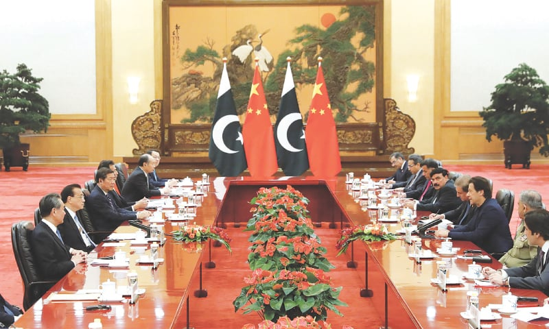 BEIJING: Prime Minister Imran Khan (third right) leads his delegation during talks with Chinese leaders, led by Prime Minister Li Keqiang (second left), at the Great Hall of the People on Tuesday.—Reuters