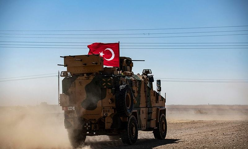 In this file photo taken on September 8, a Turkish military vehicle drives on a joint patrol with US troops in the Syrian village of al-Hashisha on the outskirts of Tal Abyad town on the border with Turkey. — AFP