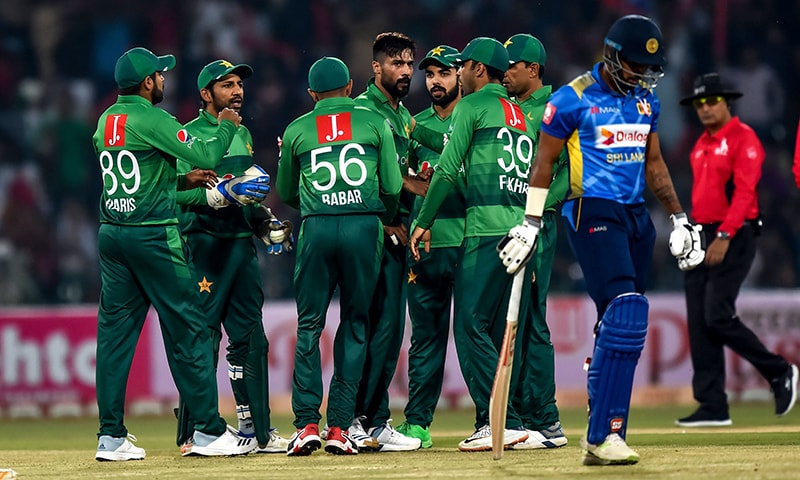 Pakistan's cricketers celebrate after the dismissal of Sri Lanka's Danushka Gunathilaka (R) during the third and final Twenty20 International cricket match between Pakistan and Sri Lanka at the Gaddafi Cricket Stadium in Lahore on Wednesday. — AFP