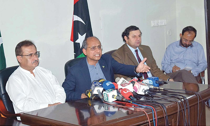 SINDH minister Saeed Ghani makes a gesture during a charged press conference as Aijaz Hussain Jakhrani and others look on. — PPI