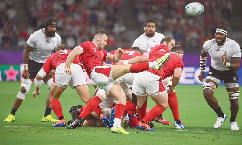 OITA: Wales' Gareth Davies kicks the ball during the Rugby World Cup Pool 'D' match against Fiji at the Oita Stadium on Wednesday. — AFP