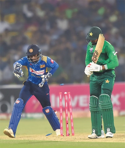 SRI LANKAN wicket-keeper Sadeera Samarawickrama (L) stumps Pakistan batsman Haris Sohail during the third T20 International at the Gaddafi Stadium on Wednesday.—AFP
