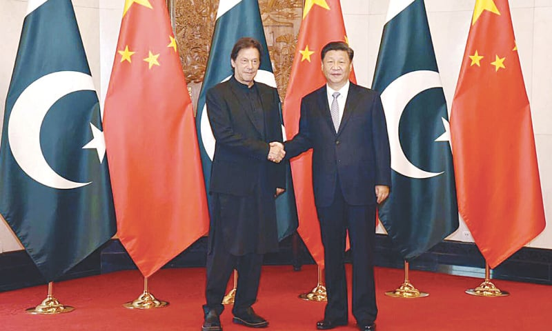 BEIJING: Prime Minister Imran Khan being received by Chinese President Xi Jinping on Wednesday.—PPI