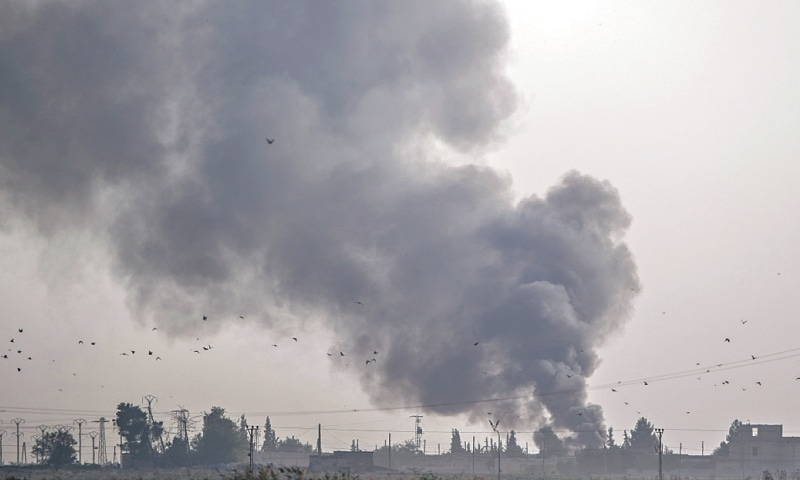 TAL ABYAD: Smoke rises in this Syrian town after bombings  by Turkish planes.—AFP