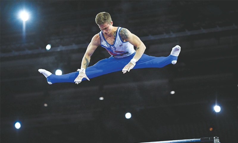STUTTGART: Russia's Ivan Stretovich performs on the horizontal bar during the Artistic Gymnastics World Championships men's team final at the Hanns-Martin-Schleyer-Halle.—AFP