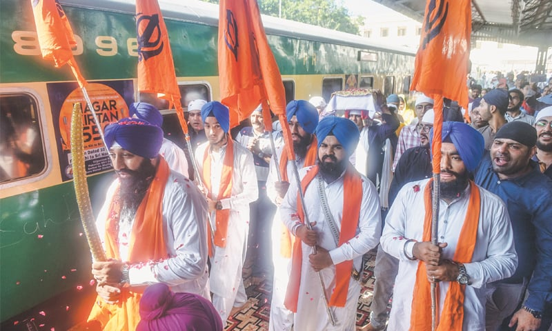 Sikh devotees carry the Guru Granth Sahib in a procession at City Station on Thursday. —Fahim Siddiqi / White Star