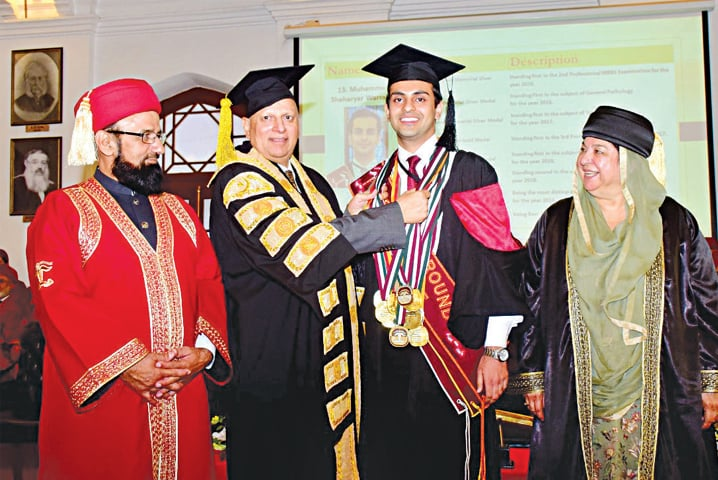 Governor Chaudhry Sarwar gives away a medal to a position holder at the King Edward Medical University convocation. — White Star