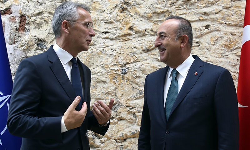 Turkish Foreign Minister Mevlut Cavusoglu, right, speaks with Nato Secretary General Jens Stoltenberg before a meeting in Istanbul on Friday.  —Turkish Foreign Ministry via AP