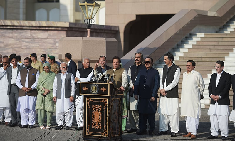 PM Imran Khan addresses a gathering in connection with a human chain event. — AFP