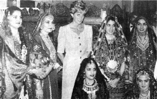 Princess Diana stands with a group of Pakistani women, performers of folk songs, at a women's centre in Islamabad. — Reuters/File