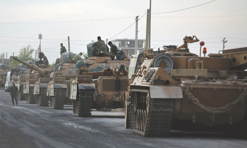 AKCAKALE VILLAGE (Near the Turkey-Syria border): Tanks are lined up on Friday as Turkish soldiers and pro-Turkey Syrian fighters prepare to take part in fighting in northeastern Syria.—AFP
