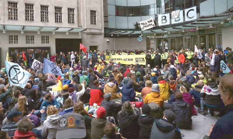 London: Climate activists protest at the BBC offices during the fifth day of demonstrations by Extinction Rebellion, a climate change action group, on Friday.—AFP