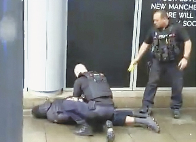 Manchester: In this image taken from mobile phone footage, police arrest a man after a stabbing incident at a shopping centre.—AP