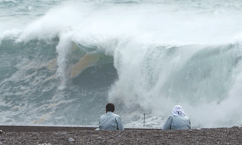 KIHO: People look at surging waves as Typhoon Hagibis approaches a port in Japan's Mie prefecture on Friday.— AP