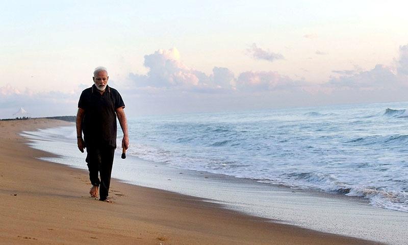 Indian Prime Minister Narendra Modi takes morning walk at a beach in Mamallapuram, in southern India on  Saturday. — Prime Minister of India Narendra Modi Twitter via AP
