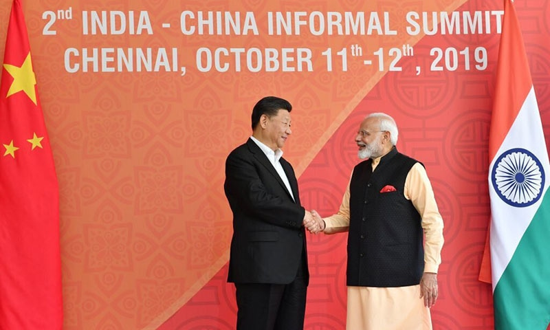 In this handout photo provided by the Indian Prime Minister's Office, Chinese President Xi Jinping and Indian Prime Minister Narendra Modi shake hands in Mamallapuram, India. — Indian Prime Minister's Office via AP