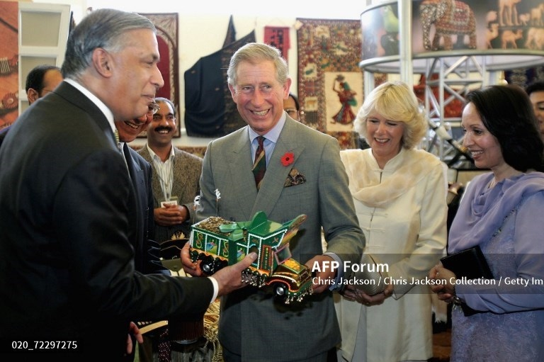 Prince Charles is given a truck as Prime Minister Shaukat Aziz and his wife and Duchess Camilla look on at Prime Minister House on October 30, 2006 in Islamabad.