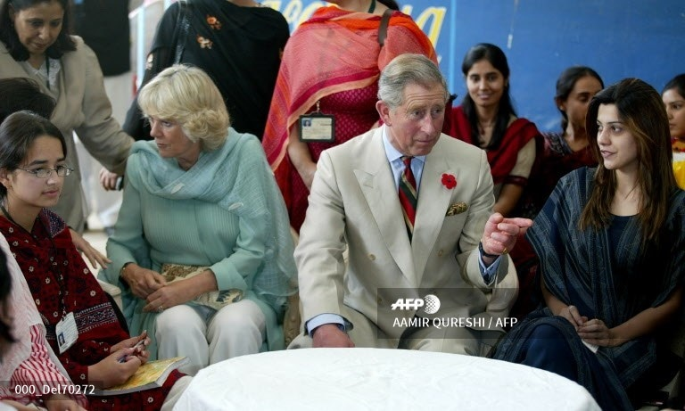 Prince Charles and his wife Camilla speak with students of Fatima Jinnah University during their visit to Rawalpindi, October 31, 2006.