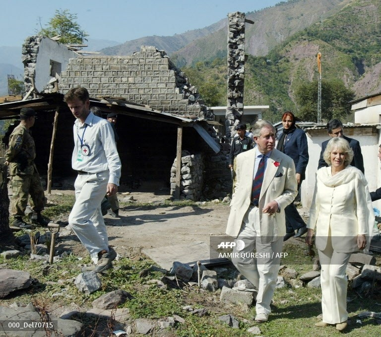 Prince Charles and his wife Camilla visit a collapsed house at the earthquake-hit village of Patika some 20km northeast of Muzaffarabad, the capital of Azad Kashmir, November 1, 2006.