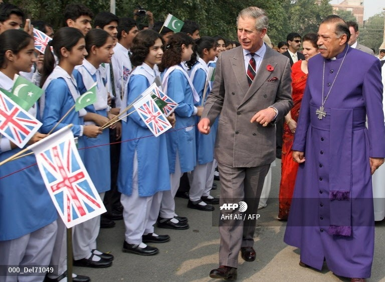 Prince Charles walks with Bishop of Lahore Alexander John Malik past a row of schoolgirls during a visit to Cathedral Church in Lahore, November 2, 2006.