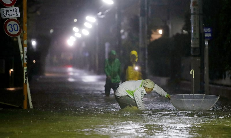 Roads are flooded due to heavy rains caused by Typhoon Hagibis at Setagaya ward in Tokyo, Japan, on Saturday. — Reuters