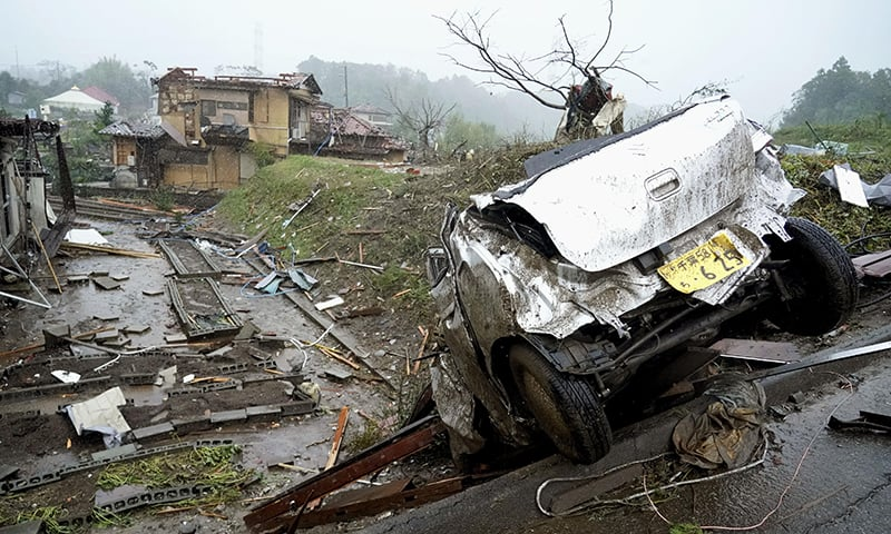A damaged car lies on the ground following a strong wind in Ichihara, Chiba, near Tokyo, Saturday. — AP