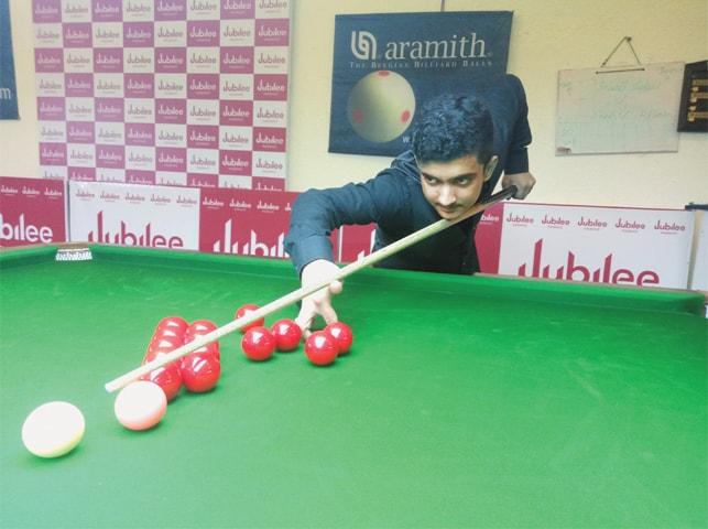 KARACHI: Shaikh Mohammad Mudassir plays a shot against Mohammad Sajjad in the third national ranking snooker championship at the Karachi Gymkhana on Saturday.