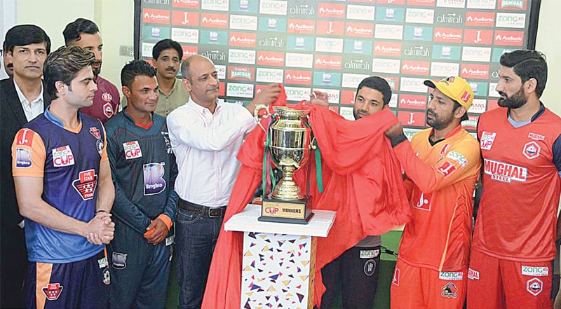FAISALABAD: Captains and representatives of six competing teams unveil the National T20 Cup trophy at the Iqbal Stadium on Saturday.—APP