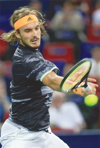 SHANGHAI: Greece's Stefanos Tsitsipas hits a return to  Daniil Medvedev of Russia during their semi-final at the Shanghai Masters on Saturday.—Reuters