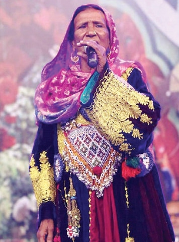 Noted folk singer Zarsanga performs in Nishtar Hall, Peshawar, on Saturday. — Dawn