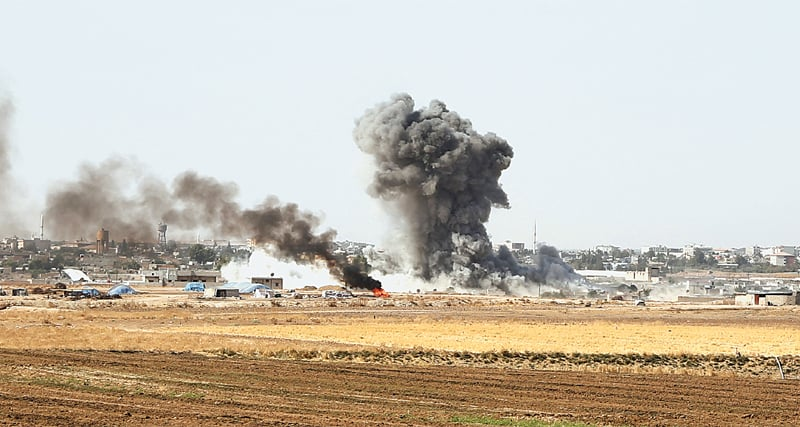 SMOKE billows from the border town of Ras al-Ain on Saturday as Turkey and its allies continue their assault on Kurdish-held towns in northeastern Syria.—AFP