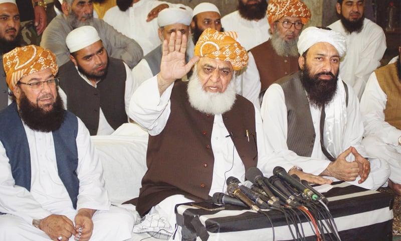 RAWALPINDI: Jamiat Ulema-i-Islam-Fazl chief Maulana Fazlur Rehman addresses a press conference on Saturday.—Online