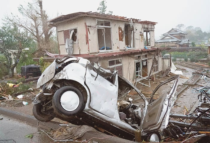 A DESTROYED house and a vehicle are seen following a strong wind in the Ichihara area near Tokyo on Saturday. Typhoon Hagibis barrelled through Japan, killing at least two people and lashing large parts of the country with 'unprecedented' rain that caused floods, landslides and emergency disaster warnings. Around 7.3 million people were given non-compulsory evacuation orders.—AP