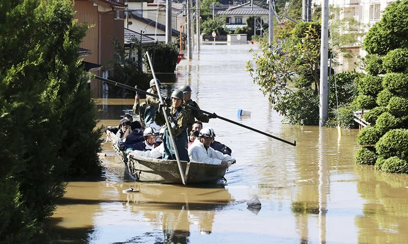 Local residents are rescued by Japapnese Defence-Force soldiers from a flooded area caused by Typhoon Hagibis in Kakuda, Miyagi prefecture, Japan on October 13, 2019, in this photo taken by Kyodo. — Reuters