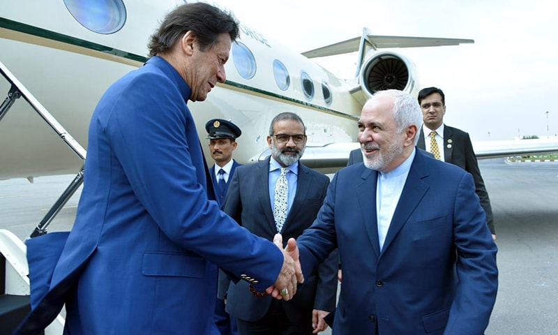 Prime Minister Imran Khan is received by Iranian Foreign Minister Javad Zarif on his arrival in Tehran for a one-day official visit. — Photo courtesy Sanaullah Khan