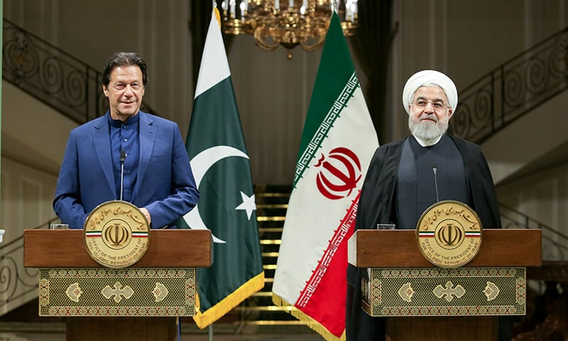 Iranian President Hassan Rouhani and  Prime Minister Imran Khan address a press conference in Tehran, Iran, on Sunday. — Reuters