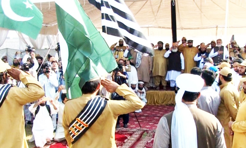 The JUI-F volunteers present a guard of honour to Rehman. — Photo provided by the author