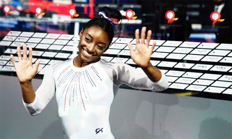 Simone Biles celebrates winning the gold medal in the women's all-around final at the Gymnastics World Championships in Stuttgart, Germany. —AFP/File