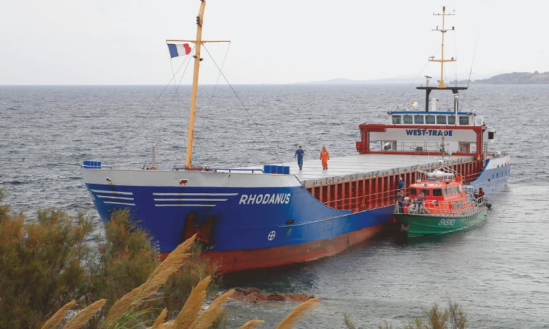AJACCIO (France): A 90 metre-long cargo ship, with seven people on board, pictured after it ran aground in Corsica on Sunday.—AFP