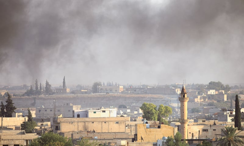 AKCAKALE: Smoke rises above the Syrian town of Tel Abyad, as seen from this Turkish town on the border  with Syria. — Reuters