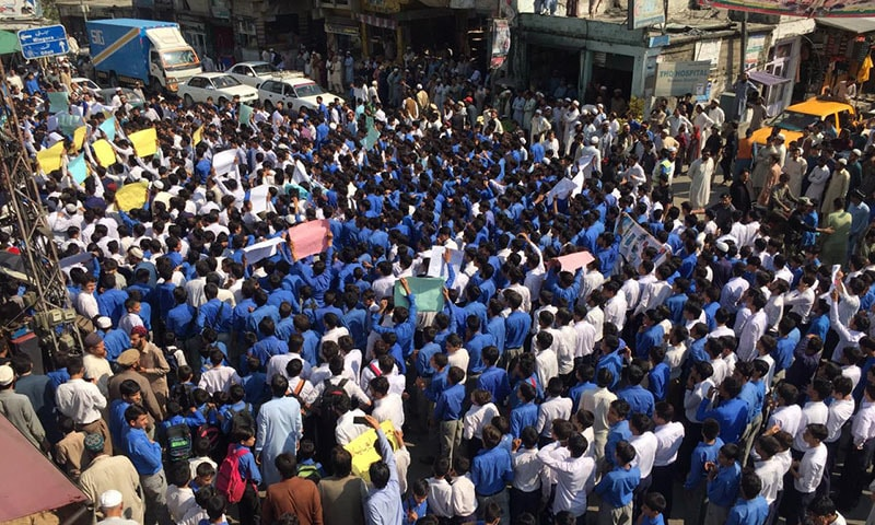 Scores of students, teachers and civil society members on Monday protested the murder of district education officer Nawab Ali in Kolai-Palas Kohistan.  — Photo provided by author
