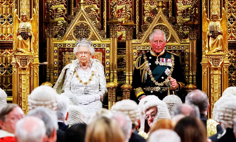Britain's Queen Elizabeth takes her seat on the Sovereign's Throne next to Charles, Prince of Wales, before reading the Queen's Speech during the State Opening of Parliament in the Houses of Parliament in London, Britain October 14, 2019. — Reuters