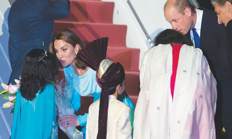 ISLAMABAD: Britain's Prince William and his wife Kate Middleton receive bouquets from children at Nur Khan Airbase on Monday.—AP