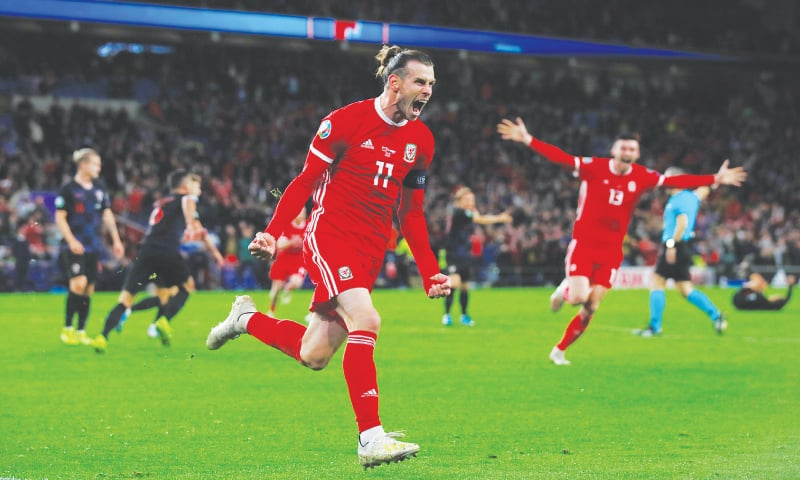 CARDIFF: Wales' Gareth Bale celebrates after scoring during the Euro 2020 qualifier against Croatia at the Cardiff City Stadium.—Reuters