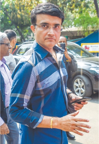 MUMBAI: Former Indian captain Sourav Ganguly gestures as he arrives at the BCCI headquarters at Wankhede Stadium on Monday to file nomination for the board's elections.—AFP