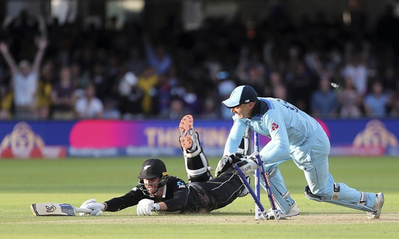 Martin Guptill was run out to crown England winners of the World Cup. — AFP