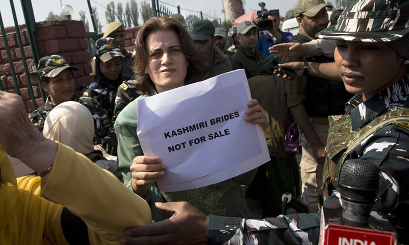 Safia Abdullah, daughter of occupied Jammu and Kashmir's National Conference party leader Farooq Abdullah, holds a placard during a protest in Srinagar, India-occupied Kashmir, Tuesday. — AP