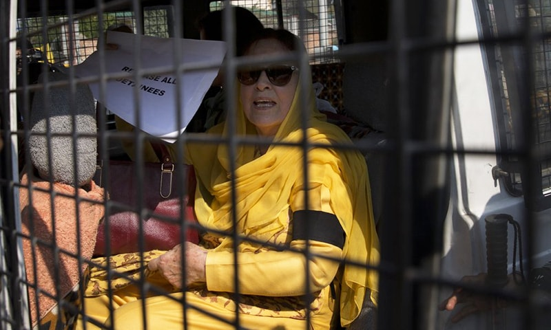 The sister of occupied Jammu and Kashmir's National Conference party leader Farooq Abdullah, holds a placard inside a police vehicle after she was detained by police in Srinagar, India-occupied Kashmir, Tuesday. — AP