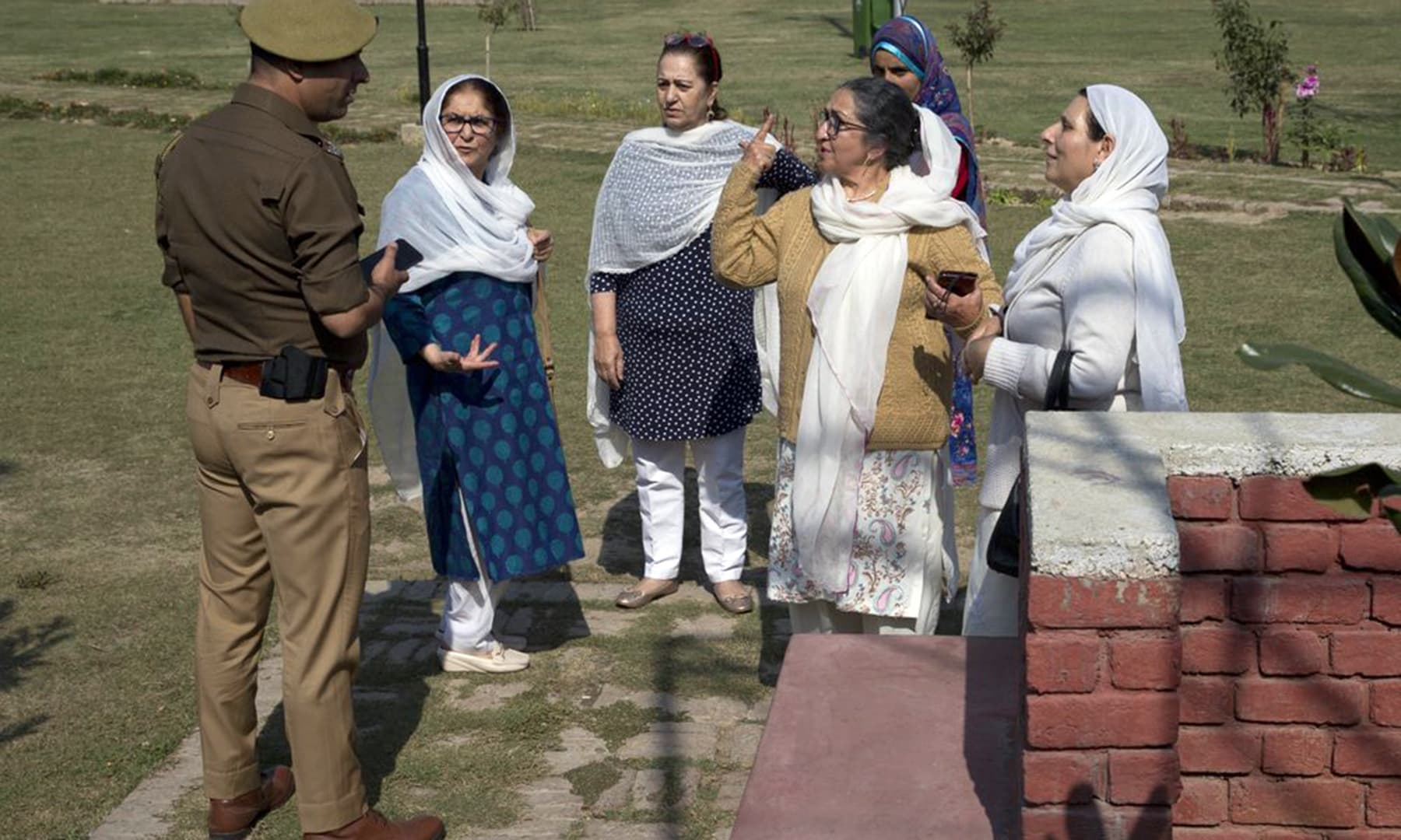 Kashmiri women argue with an Indian police officer after they were stopped from staging a protest in Srinagar, Indian-occupied Kashmir, Tuesday. — AP