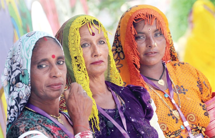 Rural women attend the conference organised by Potohar Organisation for Development Advocacy at Lok Virsa on Tuesday. — Online